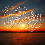 World tourism day hand lettering on blurred photo background royalty free illustration