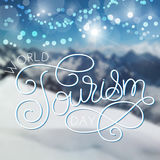 World tourism day hand lettering on blurred photo background stock illustration