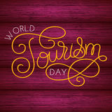 World tourism day hand lettering on wood background stock illustration