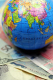 World trade. The globe on top of some banknotes Royalty Free Stock Photo