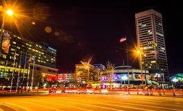 The World Trade Center and traffic on Light Street at night, in. Baltimore, Maryland Stock Image