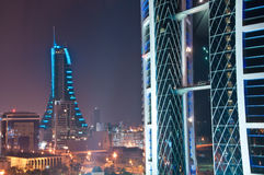 World Trade Centre, Bahrain. The World Trade Centre, Bahrain, at night and city lights beyond Royalty Free Stock Photo
