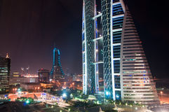 World Trade Centre, Bahrain. The World Trade Centre, Bahrain, at night and city lights beyond royalty free stock photos