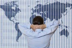 World Trade Organization. Businessman looking  to world map Royalty Free Stock Photo