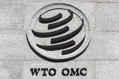 The World Trade Organization sign on a wall. Geneva, Switzerland - August 14, 2016: The World Trade Organization sign on a wall. The World Trade Organization Stock Images