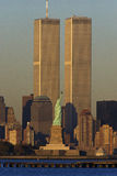 World Trade Towers. These are the World Trade Towers and Statue of Liberty at sunset. It is the view from New Jersey stock image