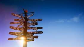 World traffic signpost with signs pointing to famous world places. World Traffic signs and directional signpost pointing to famous travel destinations with blue royalty free stock photos