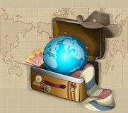 World Travel. Globe laying in the suitcase Stock Photos