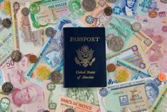 World Travel. United States of America Passport with Money from Different Countries depicting a Global/World Economy and travel. Money from Belize, Bermuda Stock Image