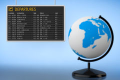 World Travel Concept. Airport Departures Board with Earth Globe Stock Image