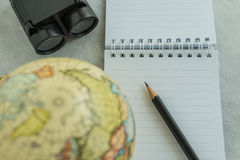 World travel concept with pencil on white note paper, binoculars Stock Photo