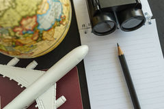 World travel concept with toy airplane, pencil binoculars, passp Royalty Free Stock Photography