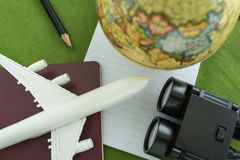 World travel concept with toy airplane, pencil binoculars, passp Royalty Free Stock Image