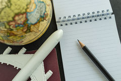 World travel concept with toy airplane, pencil , passport, note Stock Photography