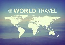 World Travel header. Contoured map of world continents with inscription World Travel and related logo. blurred photo of Earth surface and sky as backdrop Stock Photo