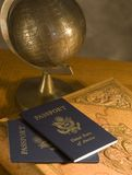 World Traveler 2. Two passports lay on a leather bound book....ready for the next great adventure royalty free stock photos
