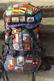 World traveler backpack covered with patches of destinations visited Stock Photo