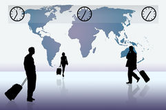 World Travelers. Silhouette of business professionals against a blue world map Royalty Free Stock Photos