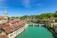 World treasure city - Bern, Switzerland. A wide-angle view of the Aare River, Ð¡hurch, bridge and houses with tiled rooftops at Bern, Switzerland royalty free stock image