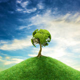 World tree concept. 3D illustration of tree foliage forming planet Earth on hill top Royalty Free Stock Photo