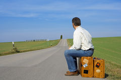 World trip. A traveler ist waiting for the bus Royalty Free Stock Photo