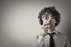 The world trough magnifying glass. Man watcing the world trough magnifying glass Royalty Free Stock Photos