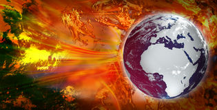 World Under Fire. Superimposed world maps on a hot/fire background Royalty Free Stock Image