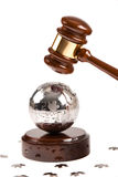 World under the hammer. Metal Puzzle Globe Under the Gavel Royalty Free Stock Image