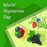 World Vegetarian Day. Fruit picnic - grass, tablecloth, plate, flowers, apple, pomegranate, dates, grapes, banana, figs. World Vegetarian Day. Food event concept Stock Photo