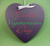 World Vegetarian Day message text written on heart shape blackboard Stock Photos