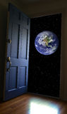 World view. Door opening to the earth  and a star-filled sky Stock Photos