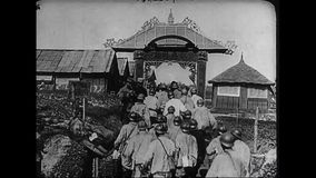 World War 1 – French colonial troops marching into a camp. World War One. Black and White. French colonial troops are marching into a camp stock video
