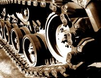 Tank Tracks and Drive Sprocket Wheel. Vintage Patton M60 American tank continuous tracks and sprocket drive wheel in vintage sepia stock photography