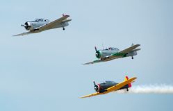 World war aerial battle reenactment. Formation of three wartime airplanes salute to military veterans Stock Images