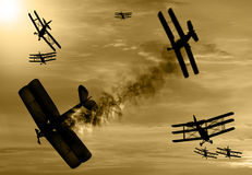 World War 1 aircraft scene. Vintage world war one biplanes and triplanes engaged in a dog fight  in a cloudy sky. One had success in shooting down the enemy Royalty Free Stock Images