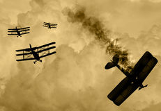 World War 1 aircraft scene. Vintage world war one biplanes and triplanes engaged in a dog fight  in a cloudy sky. One had success in shooting down the enemy Stock Images