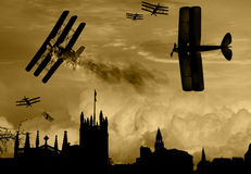 World War 1 aircraft scene. Vintage world war one biplanes and triplanes engaged in a dog fight over a country town. Success in shooting down the enemy plane Royalty Free Stock Images