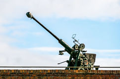 World War 2 Anti Aircraft Gun. A world war 2 anti aircraft gun located on the top of a fort guarding the entrance to a the harbour. Located in the Nothe Fort in Royalty Free Stock Images