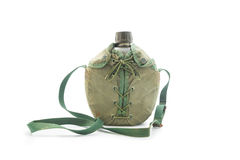 World war army water canteen with dirty green cover. Royalty Free Stock Photo