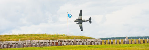 World War 2 Dakota flying low. Flypast at Fort George on 9th and 10th August 2014 of a world war 2 Dakota in the reenactment 'through the centuries' , dipping Stock Image