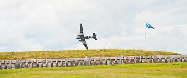 World War 2 Dakota flying low. Wing tip of Dakota flying close to barricade at Fort George in the ' through the centuries ' reenactment held on 9th August 2014 Royalty Free Stock Images