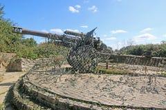 World War 2 field gun. German field gun under camoflauge netting Stock Photos