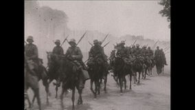 World War I – German Cavallery soldiers ride on their horses. World War I . Black and white. German soldiers ride on their horses along a road stock video
