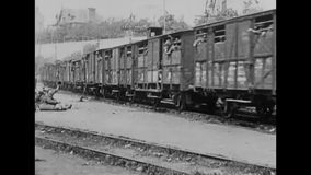 WW1 - steam train transport soldiers to the front. World War I black and white. A steam train transport soldiers in weagons to the front stock footage