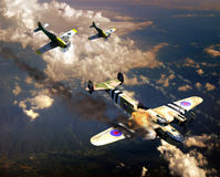 World War II aerial fight. A British Albermale plane from the second world war, attacked by two Messerschmitt 109 Royalty Free Stock Photography
