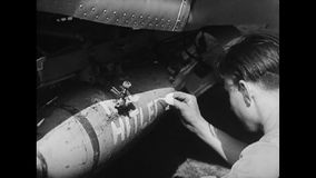 WWII - Aircraft start and parachute jump out stock footage