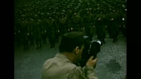 1944 - American Troops are marching through the streets of Paris. World War II, color. Soldiers move through the streets of Paris after liberation. Civil people stock video footage