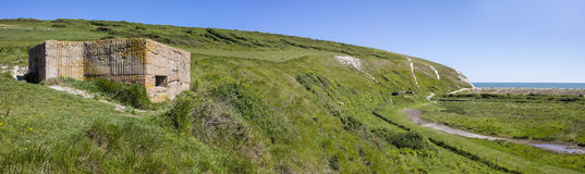 World War II Defences at Cuckmere Haven. A panoramic view showing World War II defences at the estuary in Cuckmere Haven, situated in the Seven Sisters Country Royalty Free Stock Images