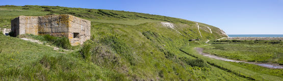 World War II Defences at Cuckmere Haven. A panoramic view showing World War II defences at the estuary in Cuckmere Haven, situated in the Seven Sisters Country Royalty Free Stock Photography