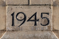 World War II. End Year of World War II Carved on a Stone royalty free stock photography